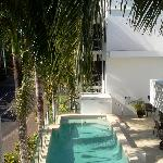  Looking at the end of our balcony to the beautiful pool area, equiped with sunlounges, and BBQ