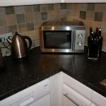 Only work surface available on Cedars kitchen other than sink drainer