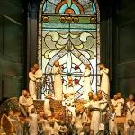 Willow Tree Angel display in front of one of our stained glass windows.