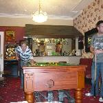  the men playing pool in the hotel