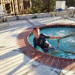 Granson in the hot tub/spa