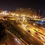 A peaceful view of Tahrir Square by night.