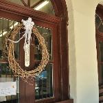 A wreath made of natural materials adorns the front door.