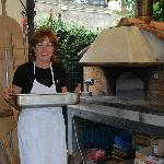 Cooking class - salt encrusted fish goes into outdoor brick oven