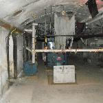 To the left, right of the blue circle is the wire with chain. Look toward the floor to see the c