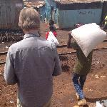 husband passing the railroad in Kibera