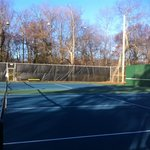 tennis courts recently redone and include a wood back side f