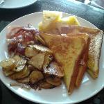 French toast stuffed with cream cheese and cherry jam with bacon and American home fries