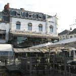 The Century Hotel with its extensive restaurant terraces on two floors.