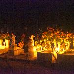 Celebrating Dia de los muertos in village cemetery