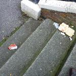 Refuse on the steps to the street at the hotel entrance