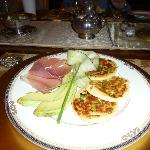 Savory pancakes, shaved cucumber and serrano ham