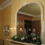  A big mirror on the top of the fire place, room 1
