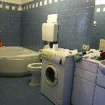Bathroom with tub and clothes washer