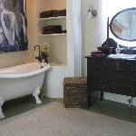Clawfoot tub and antique dresser in Sara's room