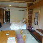 Room with western twin beds and tatami section