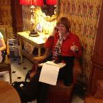 Vivian in the parlor working on airline plans.