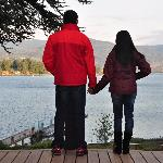 couples admiring the lake view from the deck