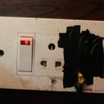 Unsafe electricals next to the bed