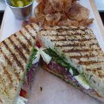 Grilled Tomato Pesto Basil with (fresh mozzarella & prosiutto Sandwich, freshly made chips/pickl