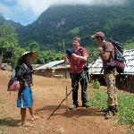 Our guide, Teng, and customers arriving at a Hmong village deep in the Laos mountains.