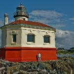 View of Coquille River light showing a size comparison with a person.