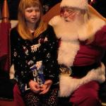 My daughter meeting Santa in his house