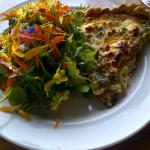 Quiche and salad with fresh flowers
