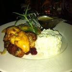 pork sirloin wrapped in bacon served with cranberries and goat cheese
