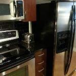 Microwave, Range, Toaster, and Refridgerator with Icemaker and Water Dispenser.