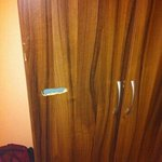 recess hacked into wardrobe door to receive bedroom door handle. Apt 18 Spectrum