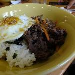 Bibimbap consists of rice, grilled beef, egg and seaweed flakes
