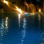 Pool At Night With Waterfall On Beautiful