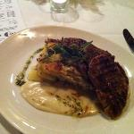 pork medallions with potatoes gratin and honey cheese sauce