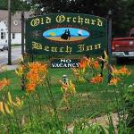 Sign out front with part of the beautiful gardens!