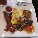 Ham and cheese omelet w/ bacon and potatoes
