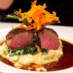 Slow roasted rack of lamb on truffled mash and carrot with creamed baby spinach and shallot jus