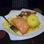 "Salmon maracuya--Baked salmon on a bed of passion fruit ""maracuya"" sauce, served with rice"