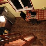  View from the loft of the apartment suite, looking down into the kitchen
