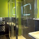 Very nice shower and heated towel racks