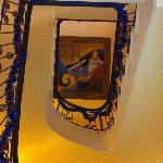 Artwork atop the staircase