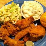 Fried chicken wing dinner with cornbread muffin, coleslaw, and potato salad