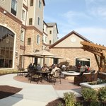 Enjoy our patio area with fire pit, sitting, and gas grills.