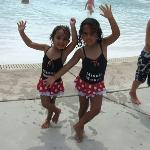 my daughters dancing by the kiddie pool.