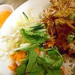 Vermicelli noodle with grilled beef and egg rolls