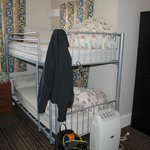 Room 14 - You can see the lockers and the basket next to the head of the top bunk