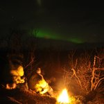 Northern lights and bonfire