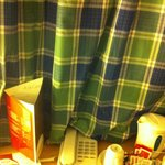 Curtain drawn covers the kettle and phone