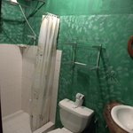 Very basic clean bathroom with fresh paint & electric overhead shower water heater
