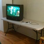 Tv on burnt folding table.